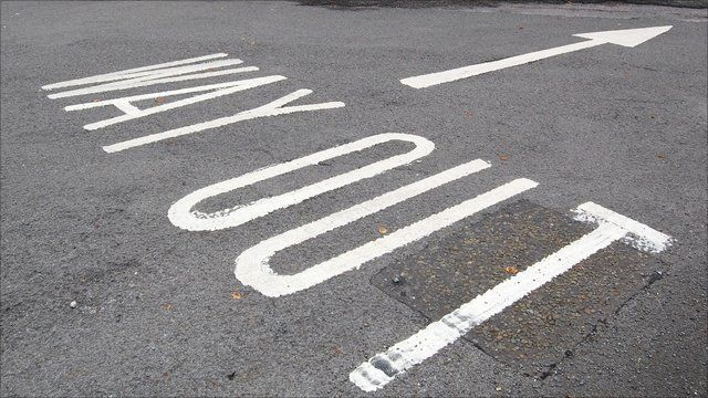way out road marking