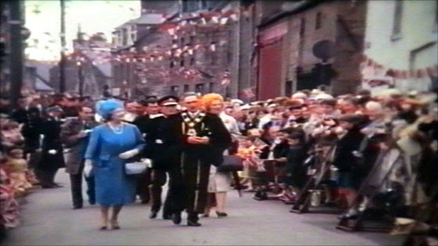 The Queen Mother with crowds lining the streets in Stonehaven in 1963
