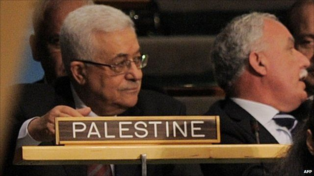 Palestinian President Mahmoud Abbas (L) sits with the Palestine delegation during the United Nations General Assembly