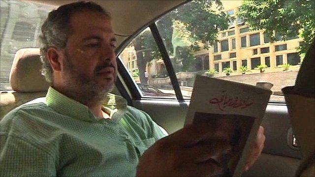 Taxi passenger reading a book