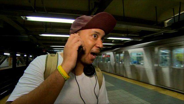 New York commuter using phone on the subway