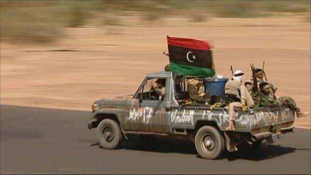 Rebel fighters on the search for Col Muammar Gaddafi