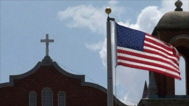 US flag and church