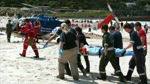 Medics with shark attack victim Michael Cohen