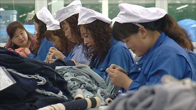 Women sewing in a textile factory in China