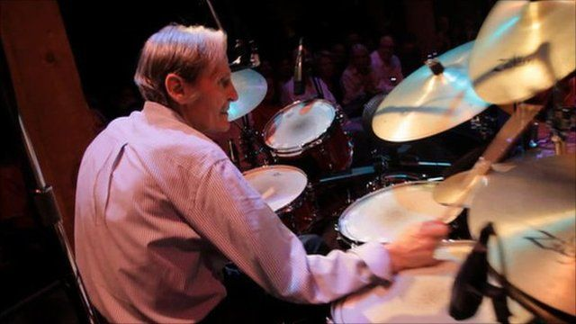 Levon Helm playing drums