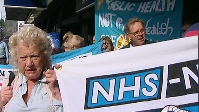People on NHS reforms protest march
