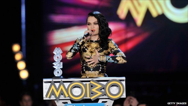 Jessie J accepts an award at the Mobo Awards 2011