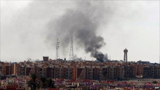 Smoke rising from buildings in Sirte
