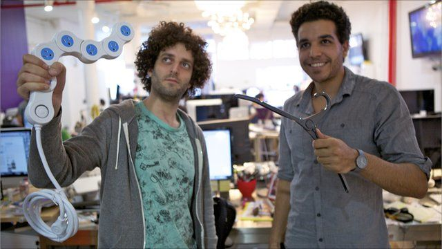 Quirky.com workers holding inventions
