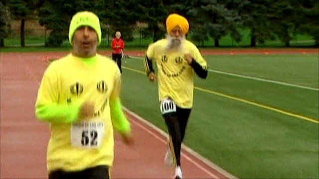 Fauja Singh (right) and his translator and coach Harmandar Singh (left)