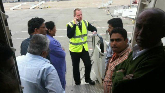 Passengers talking to ground crew