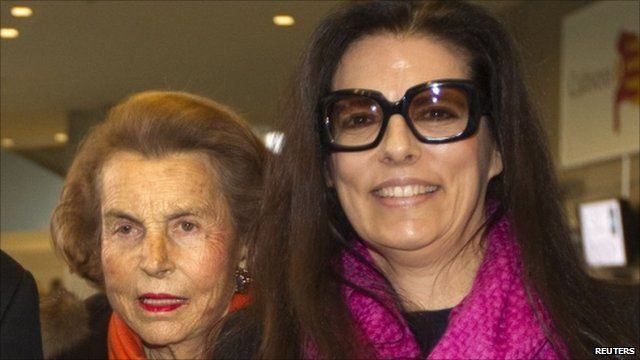 Liliane Bettencourt (L) and her daughter Francoise Bettencourt-Meyers (R) in March 2011