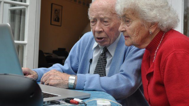 George Higgs showing Stella Fawcett how to use a computer