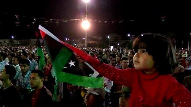 Girl waving Libyan flag