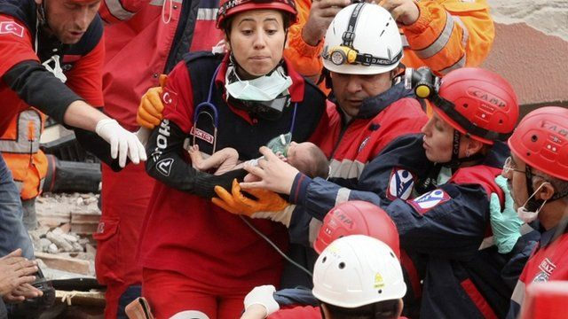 Two week old baby rescued from rubble