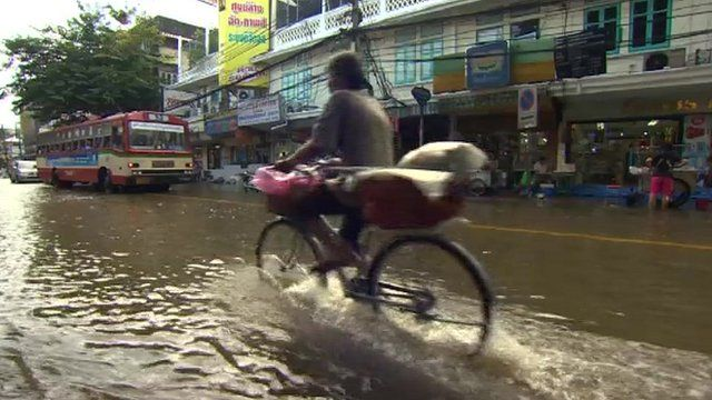 A cyclist on a flooded Bangkok street