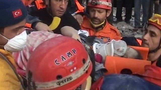 Teacher pulled from rubble