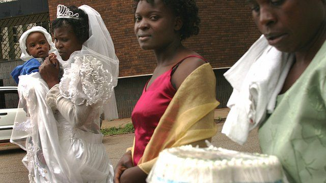 Women and a child during a wedding in Zimbabwe