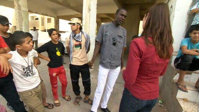 Residents of Abu Salim with Katya Adler