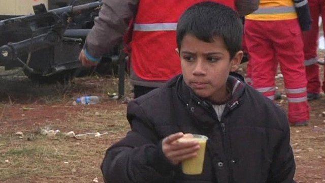Boy drinking soup