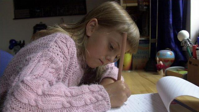 Young girl doing homework (generic)