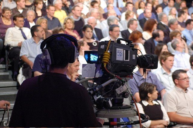 Camera man directs his lens at the studio audience at BBC Television Centre