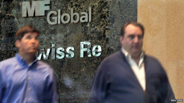 Two men exit the office complex where MF Global Holdings Ltd have an office in New York