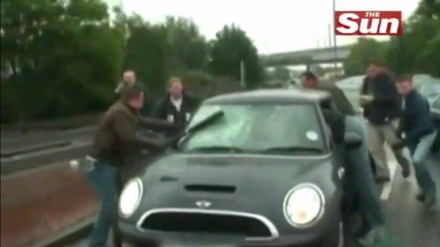 Police officers smash stolen car