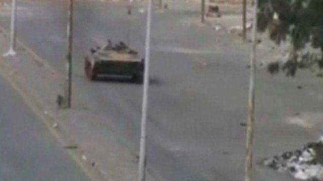Tank in empty street in Homs
