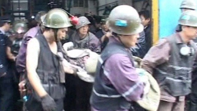 Miner carried out on stretcher by rescue workers