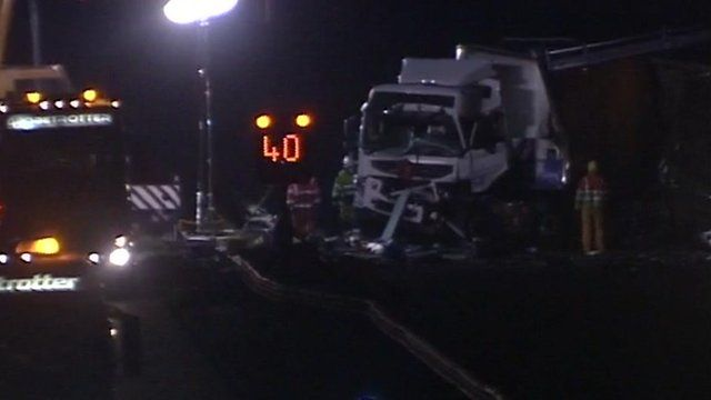 Damaged front of truck with recovery vehicles alongside