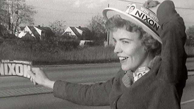 Nixon campaigner waves sign in 1960 Levittown, PA