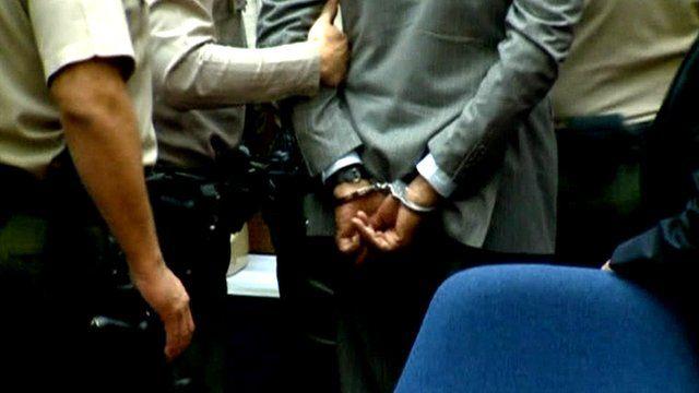 Dr Conrad Murray in handcuffs