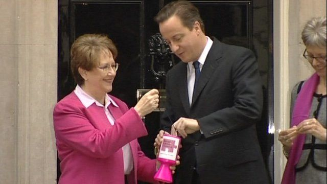 David Cameron giving money to cancer charity