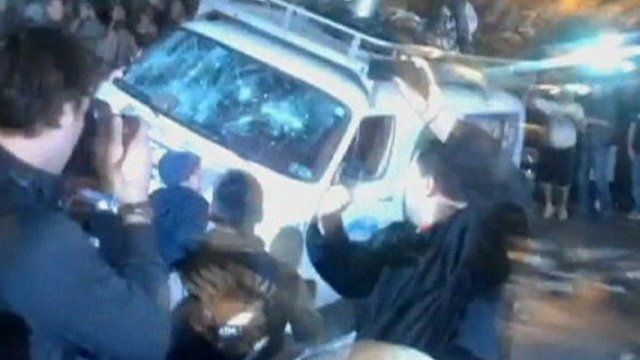 Penn State students attack a news van