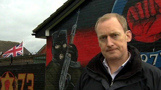 The BBC's Andy Martin in front of a paramilitary mural