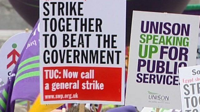 Placards calling for strike action over pension changes