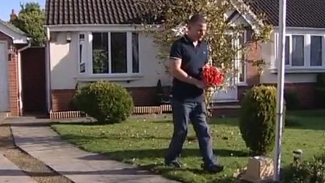 Aron Shelton, wounded former soldier, carrying bouquet of poppies