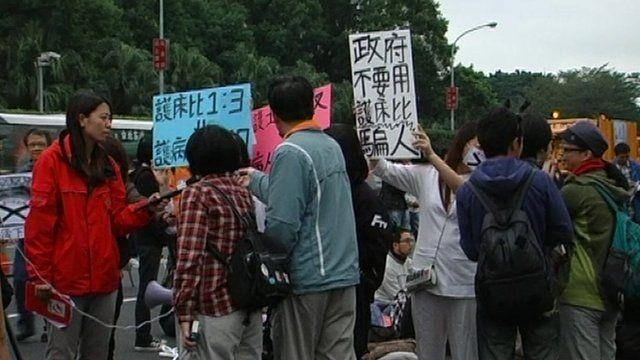 Workers demonstrating in Taiwan against unpaid mandatory leave