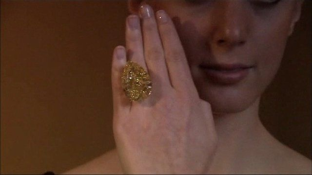 Model wears 110-carat yellow diamond ring