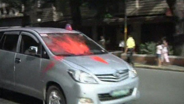 Car with red paint on windscreen