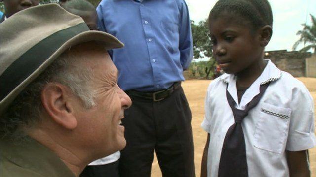 Greg Palast speaks to school child in Democratic Republic of Congo