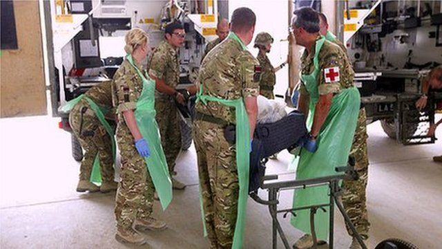 Military medics working at Camp Bastion hospital receive a battlefield casualty