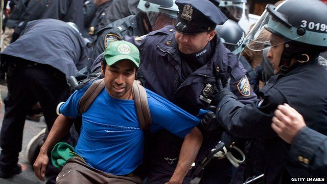 Occupy Wall St protester being arrested by New York police
