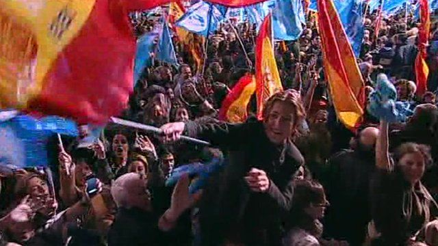 Spanish conservative waves Spanish flag amid jubilant crowd