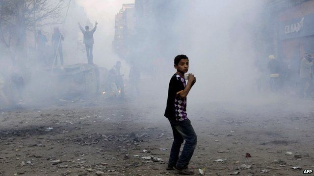 Young boy joining the protests in Cairo