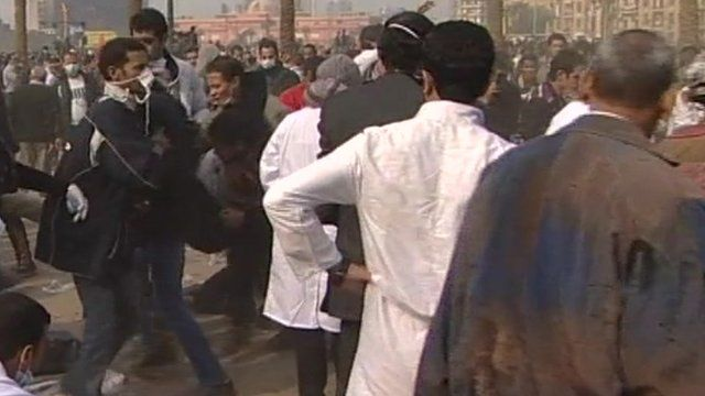 Protesters in Tahrir Square being taken for medical care.