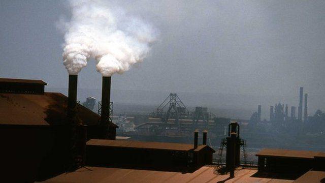 Smoke billows from factory chimneys