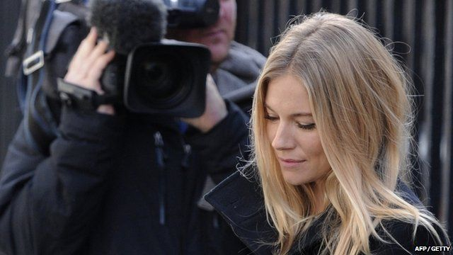 Actress Sienna Miller (R) leaves after giving evidence at the Leveson Inquiry